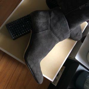 MK heeled boots.